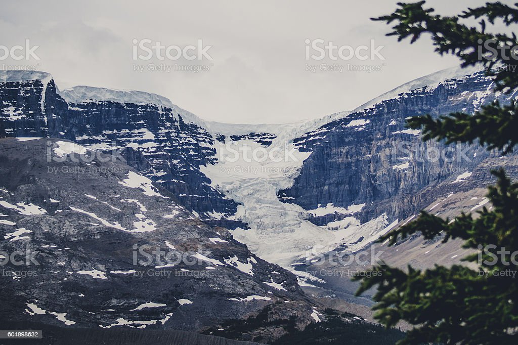 Avalanche on rough rocky mountains stock photo