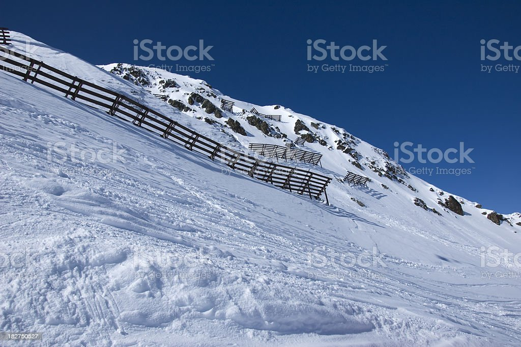 Avalanche protection fences in the mountains stock photo