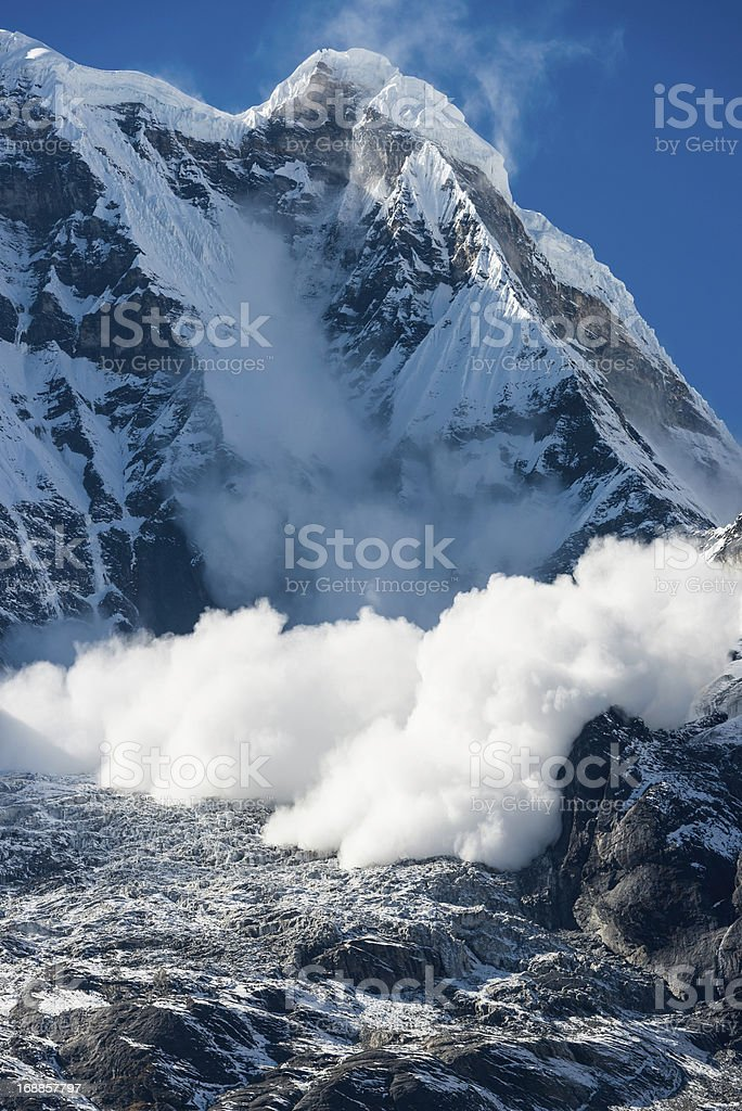Avalanche thundering down Annapurna Himalayas mountains Nepal stock photo