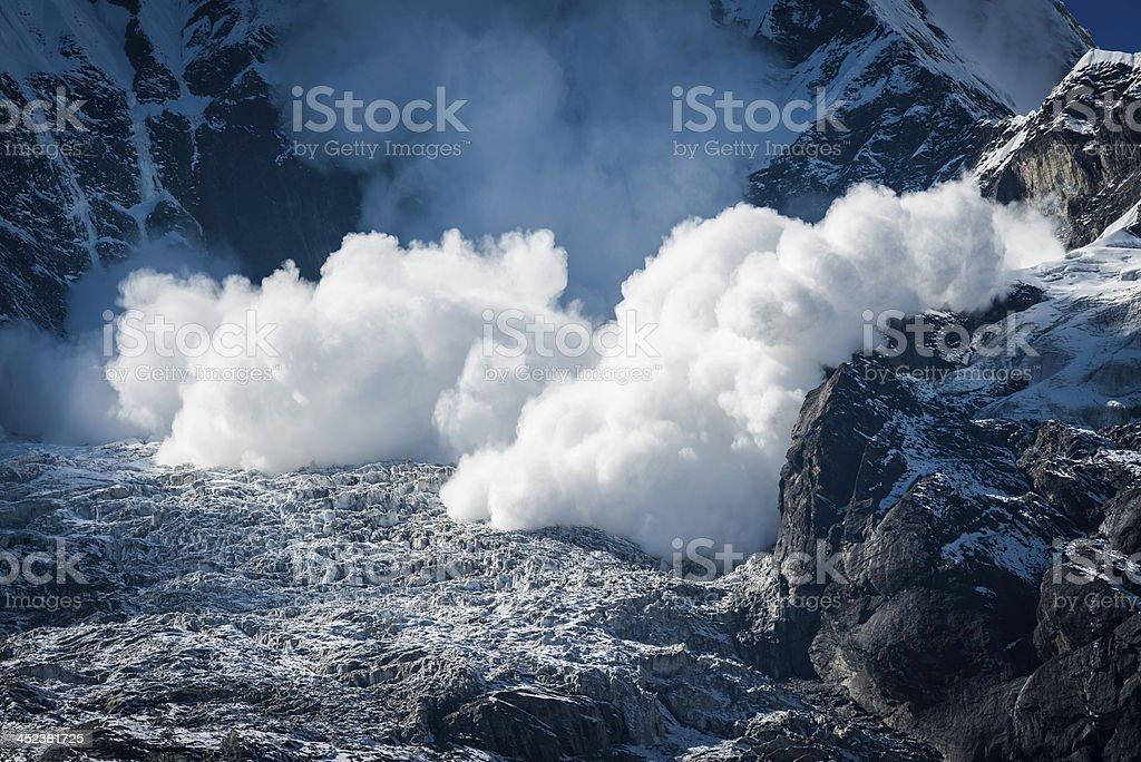 Avalanche thundering down snow mountain glacier Annapurna Himalayas Nepal stock photo