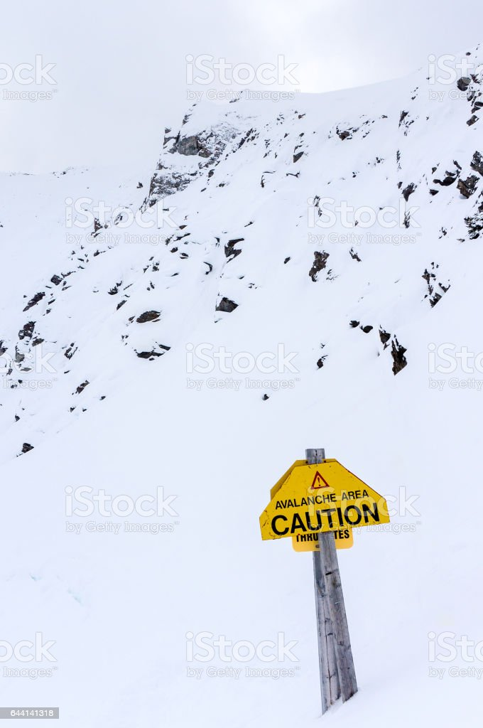 Avalanche Warning Sign on Whitehorn Mountain in Lake Louise stock photo