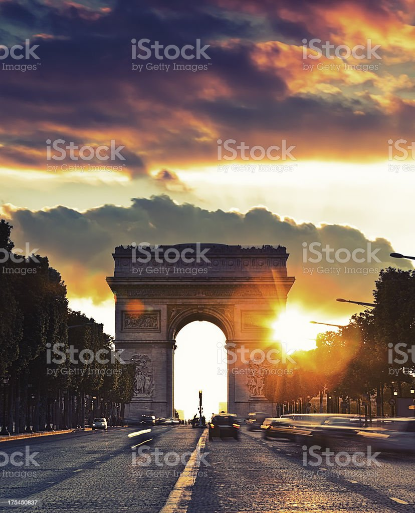 Avenue des Champs-Elysees with Arch of Triumph during sunset stock photo
