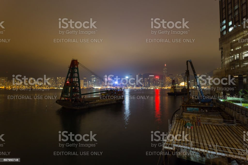 Avenue of stars is under construction and Hong Kong buildings at night in the background stock photo