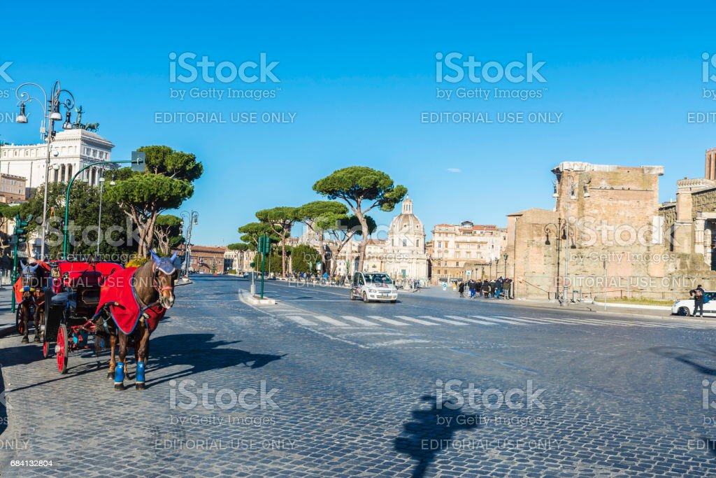 Avenue with horse carriages in Rome, Italy. stock photo