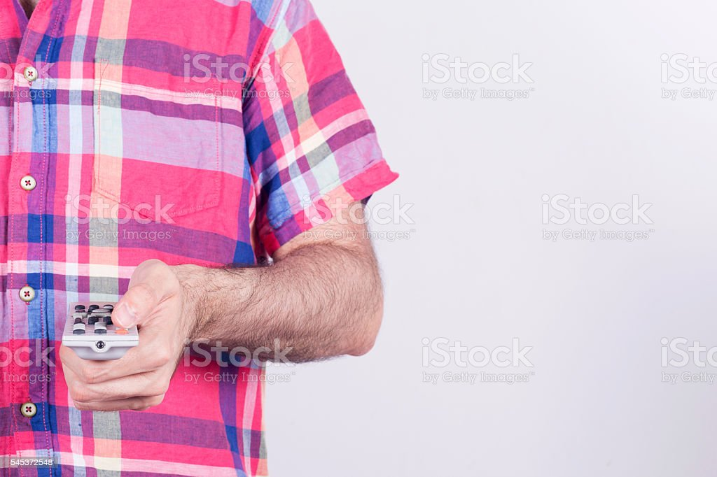 Average man holding a remote control. stock photo