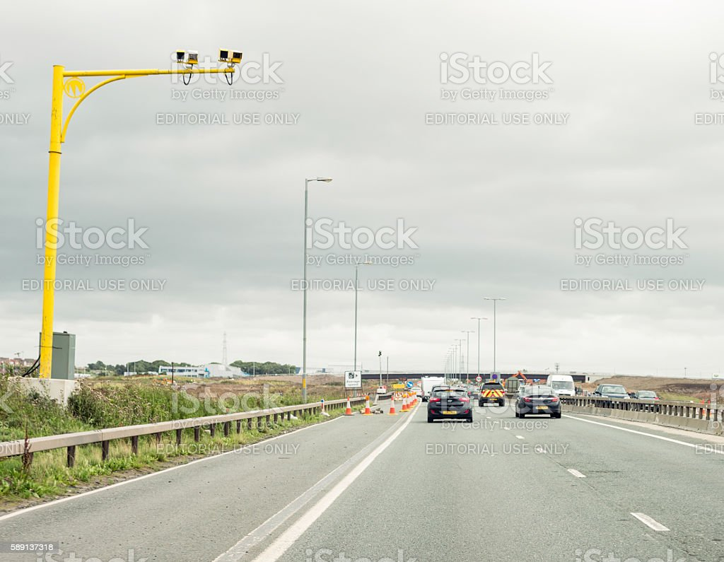 Average speed cameras on a British motorway with roadworks stock photo