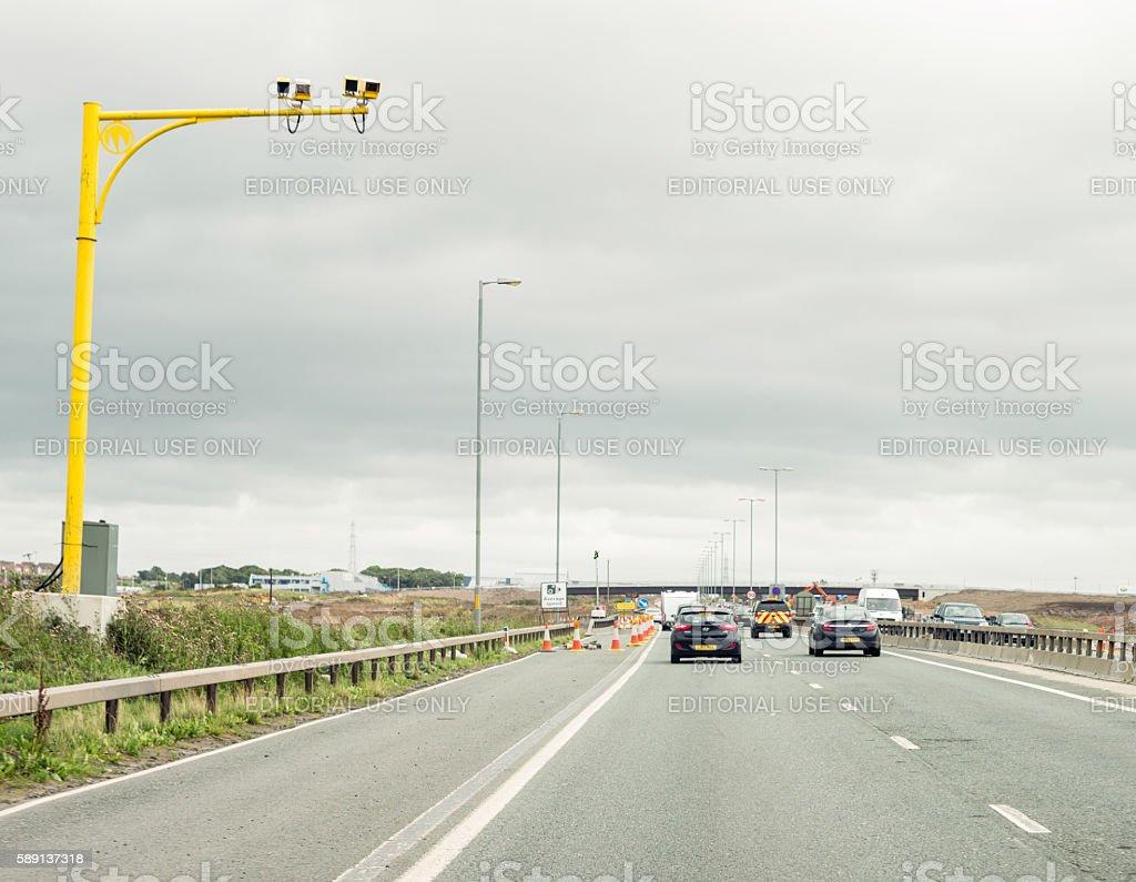 Average speed cameras on a British motorway with roadworks stock photo