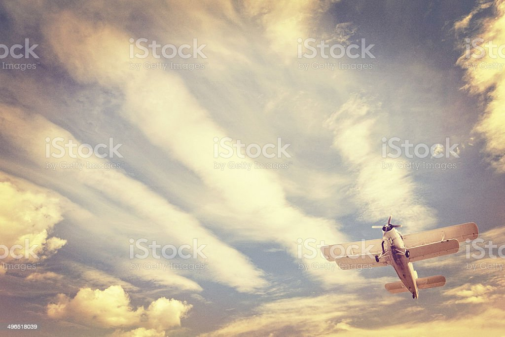 Aviation Instagram, old low-flying airplane against moody sky, retro look stock photo