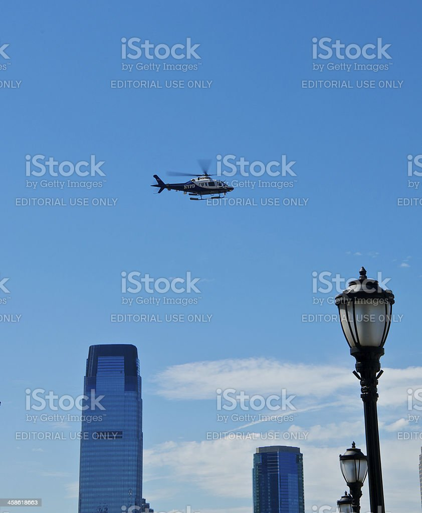 NYPD Aviation Unit helicopter over Hudson River, Lower Manhattan NYC royalty-free stock photo