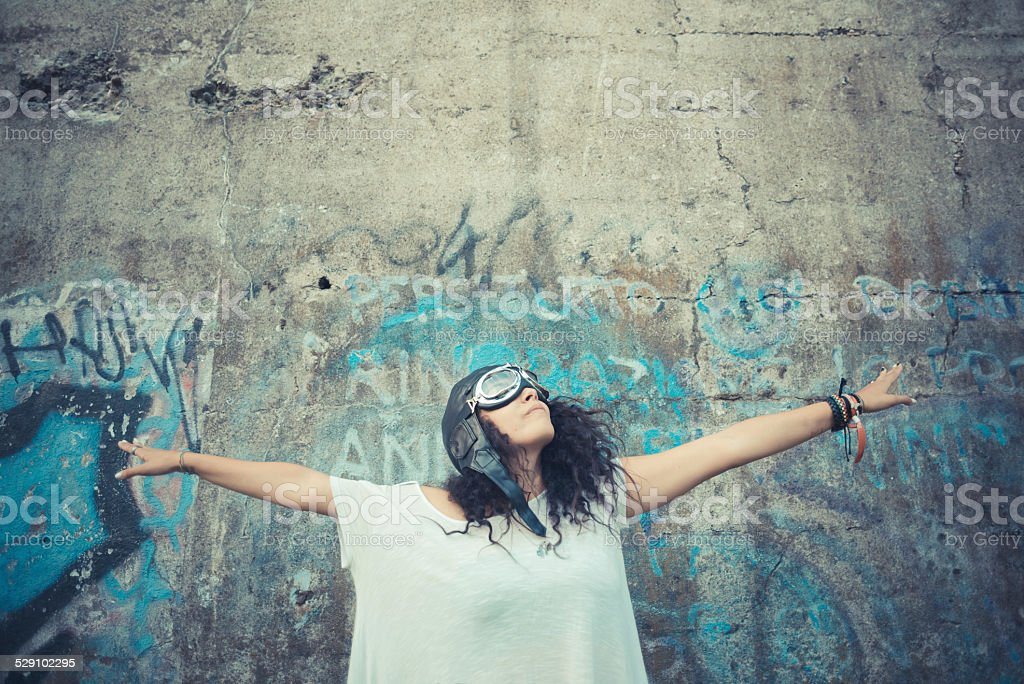 aviator funny  young beautiful moroccan curly woman stock photo