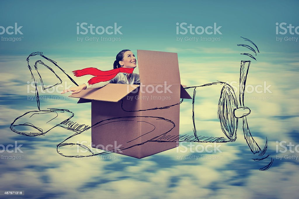 aviator woman with scarf flying designed airplane at high altitude stock photo