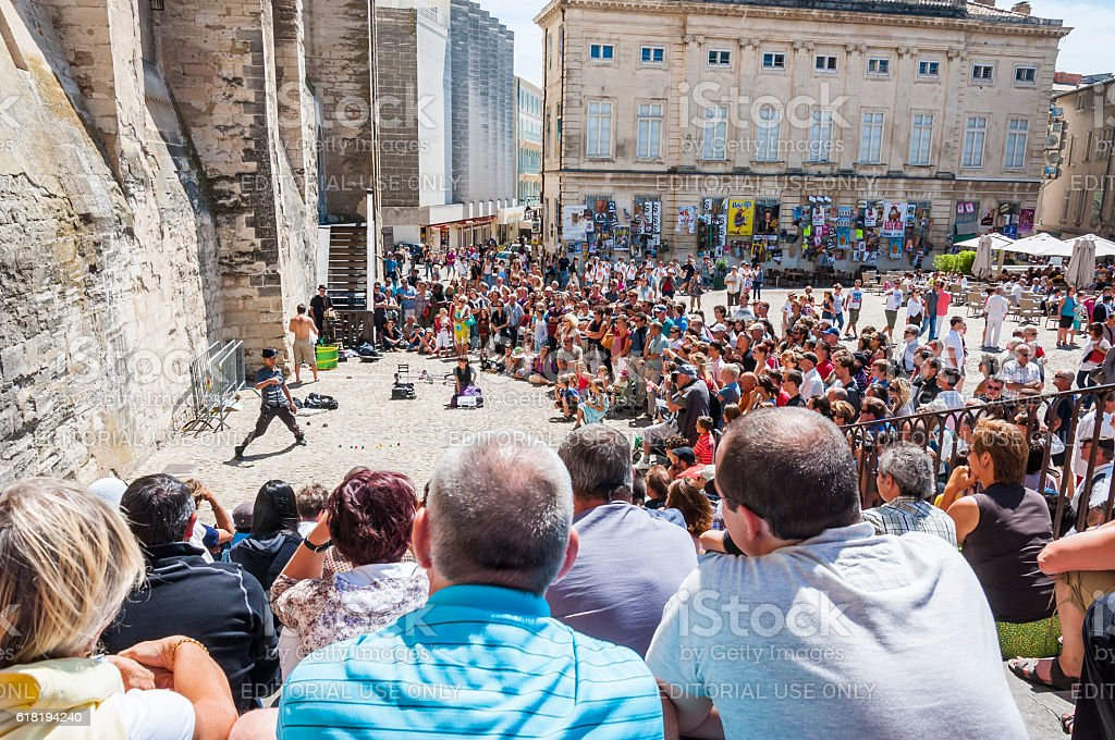 Avignon, Palais Des Papes, Front Square, people watching arstists show. stock photo