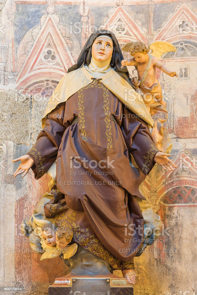 Avila - The polychrome carved statue of St. Theresia stock photo