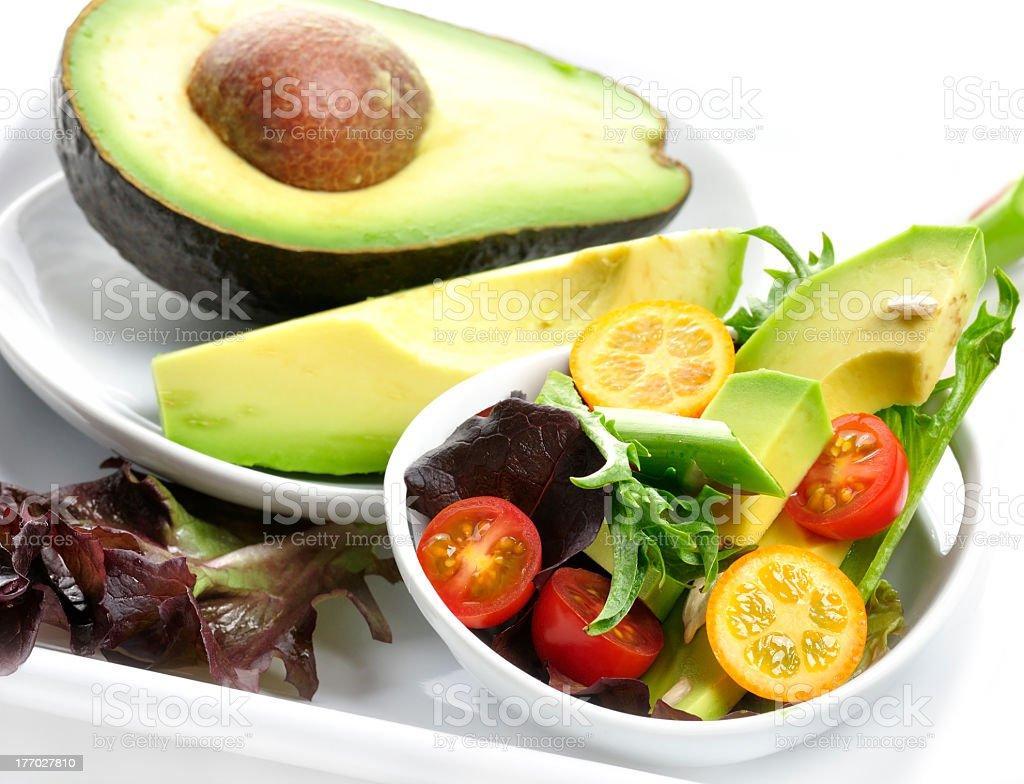 Avocado and avocado salad with mini tomatoes royalty-free stock photo