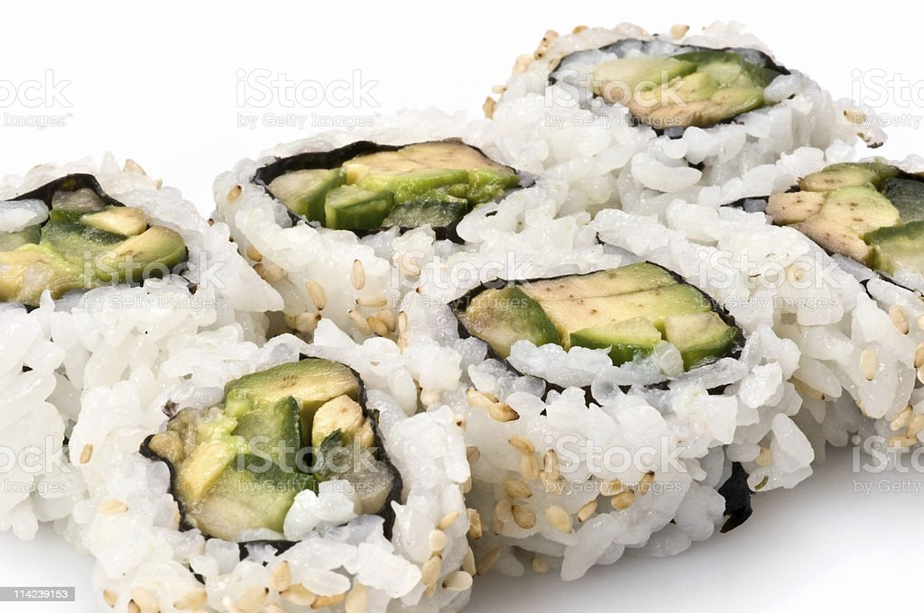 Avocado and cucumber sushi roll stock photo