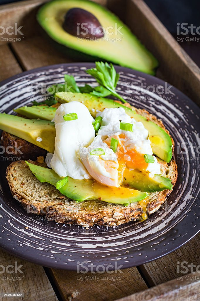 Avocado and poached egg toast stock photo
