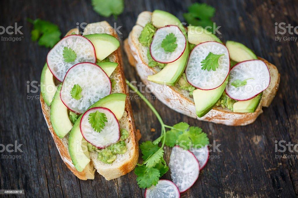 Avocado and Radish toast stock photo