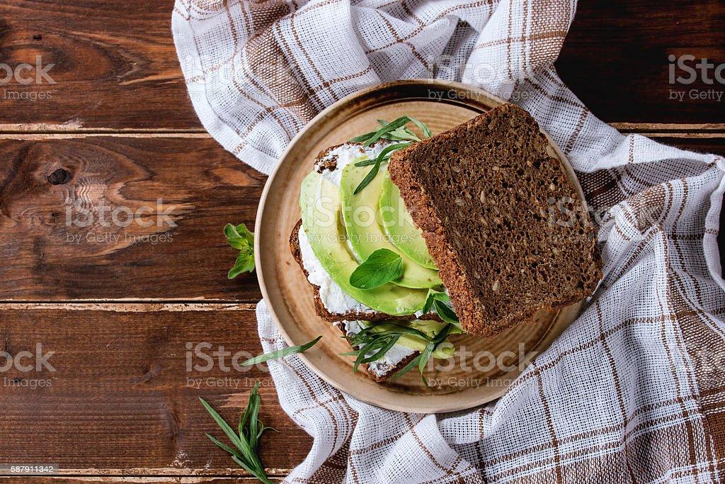Avocado and ricotta sandwich stock photo