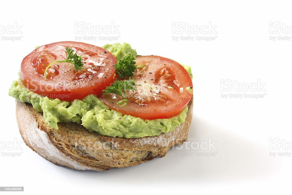 Avocado and Tomato on Rye Toast royalty-free stock photo
