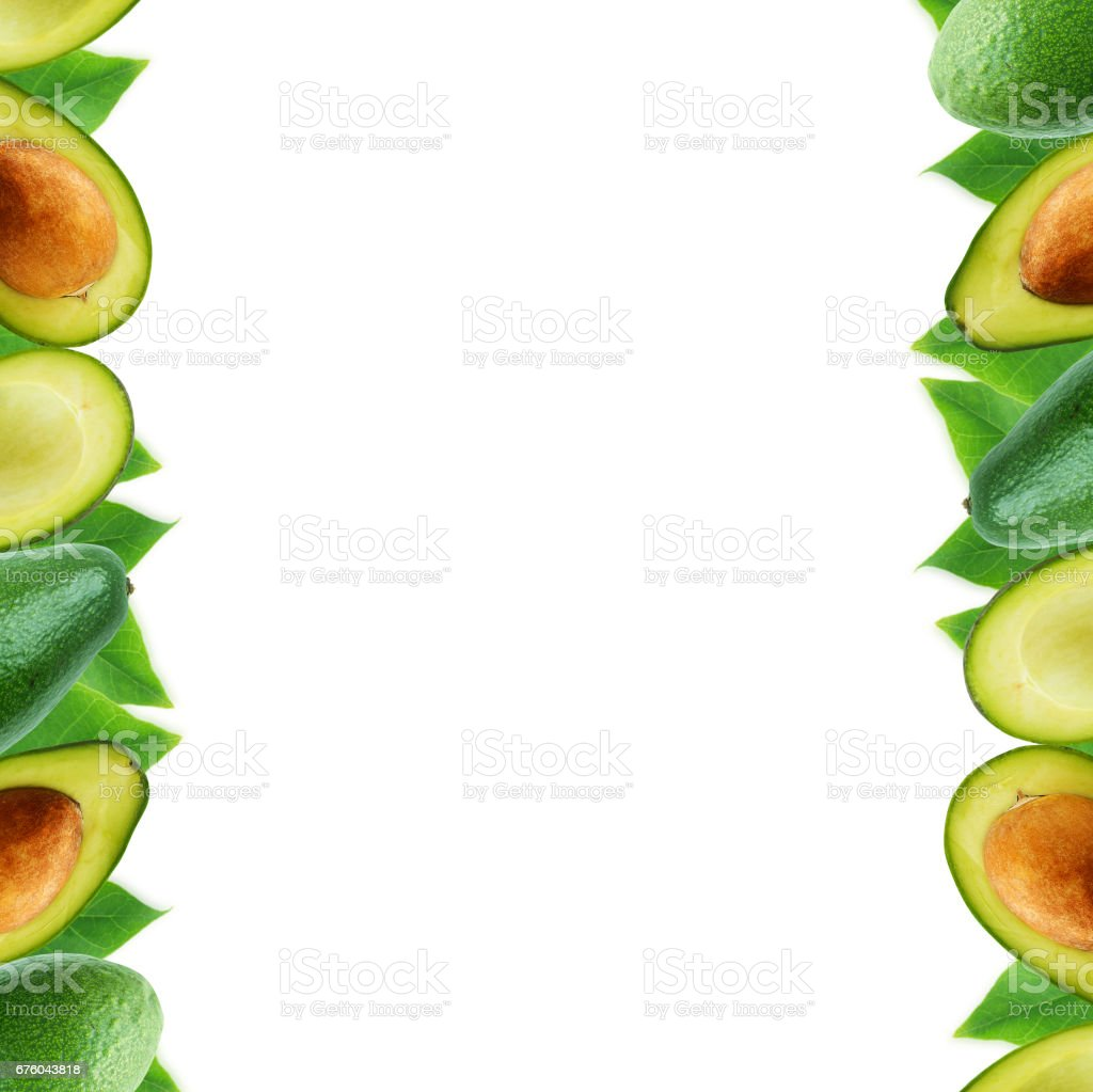 Avocado at border of image with copy space for text. stock photo