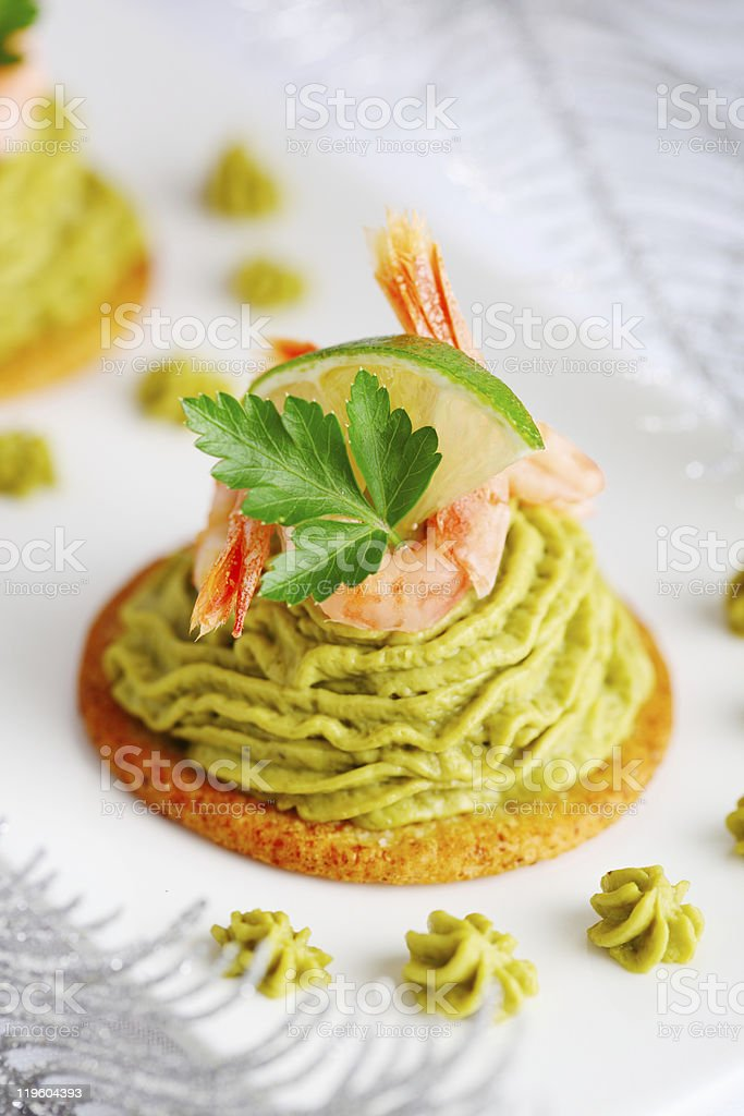 Avocado cream and prawns on crackers for Christmas stock photo