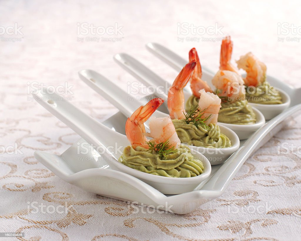 Avocado cream and shrimp in spoon royalty-free stock photo