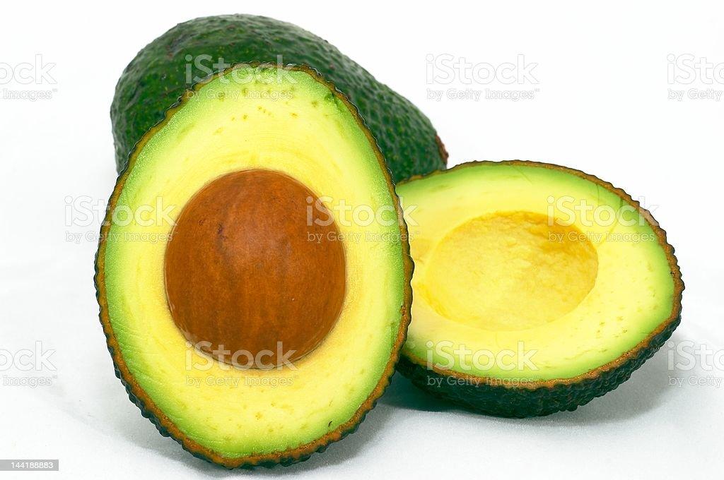 Avocado cut and whole royalty-free stock photo