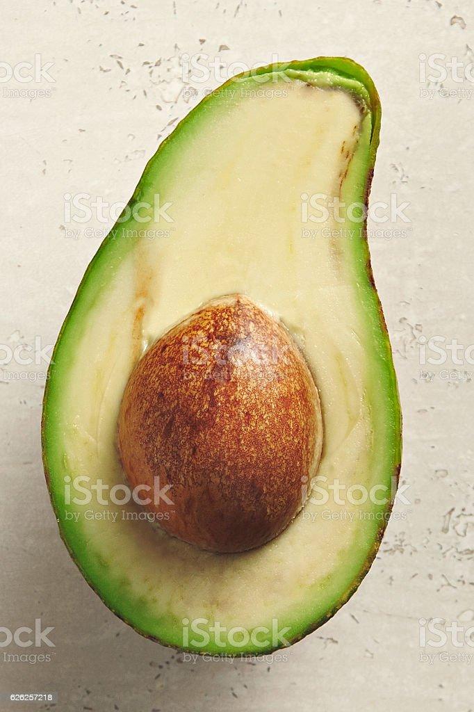Avocado cut in half on white stock photo
