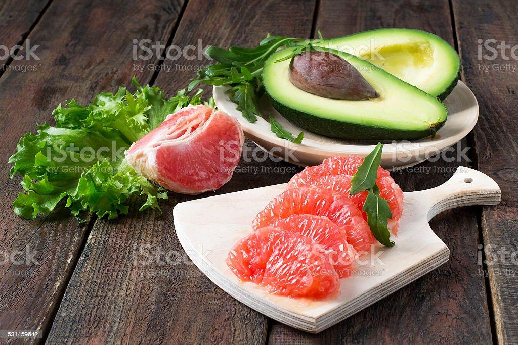 Avocado, grapefruit, arugula and lettuce stock photo