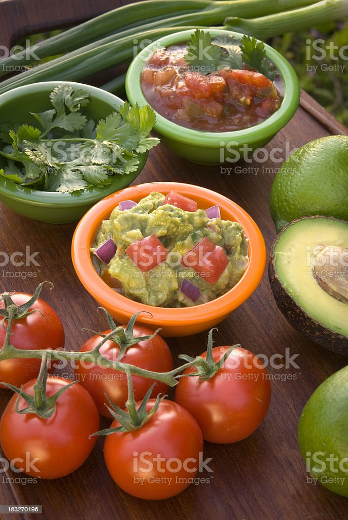 Avocado Guacamole Dip & Tomato Mexican Summer Picnic Snack Food Appetizer royalty-free stock photo