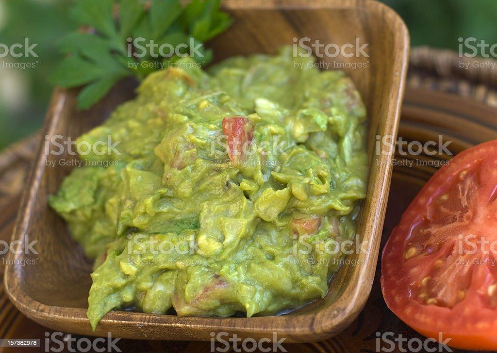 Avocado Guacamole, Mexican Food Dip Side Dish & Fresh Tomato royalty-free stock photo