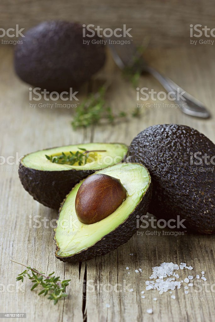 Avocado half with herb thyme stock photo