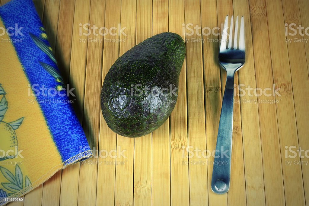 Avocado on Bamboo Placemat Effect royalty-free stock photo