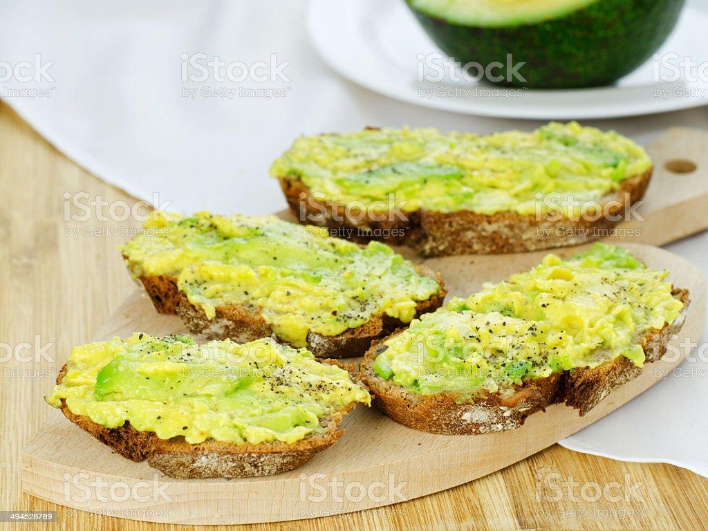 Avocado on bread stock photo