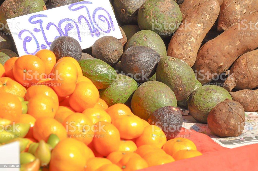 avocado , orange and yacon fruit stock photo