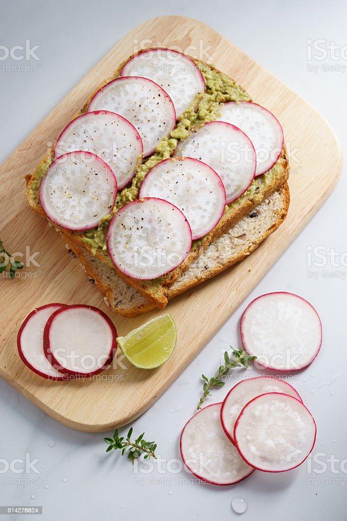 avocado radish toast stock photo