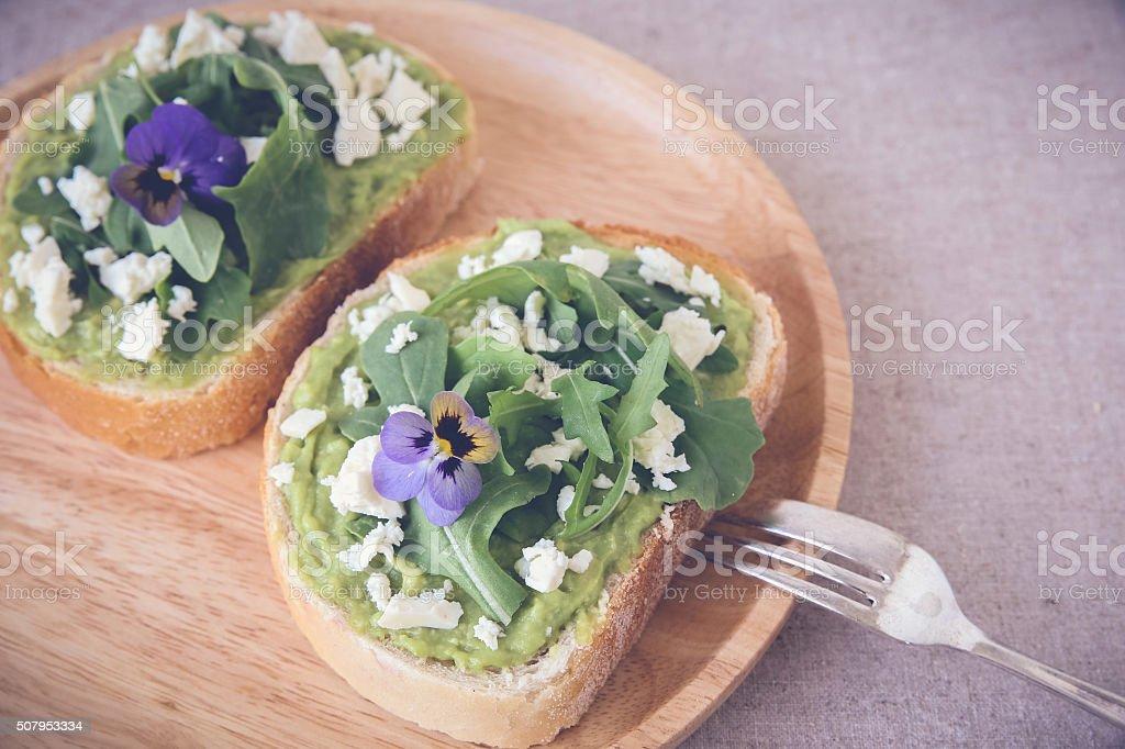 Avocado rocket feta sourdough open face sandwiches toast,toning stock photo