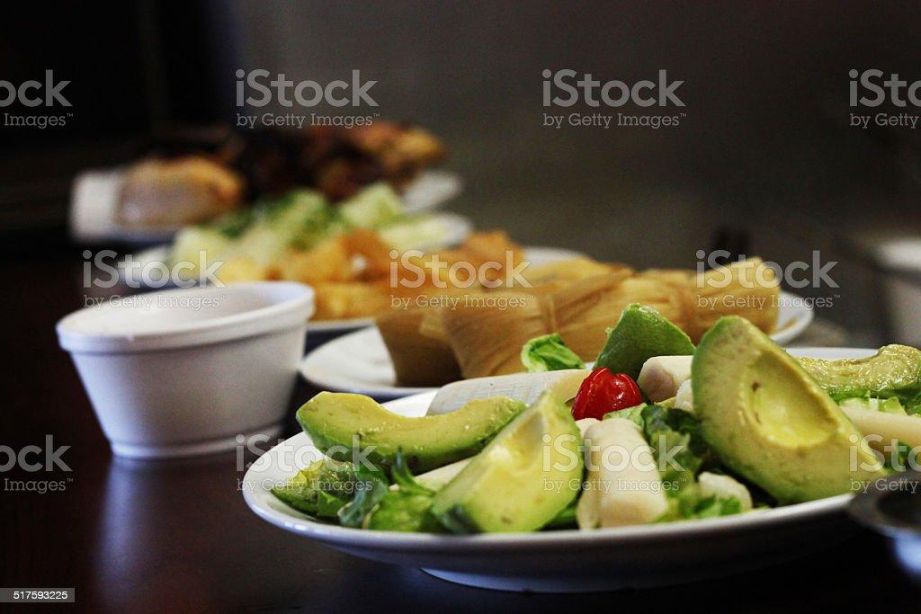 Avocado salad and palm heart, bollos, arepas y yucca fried stock photo