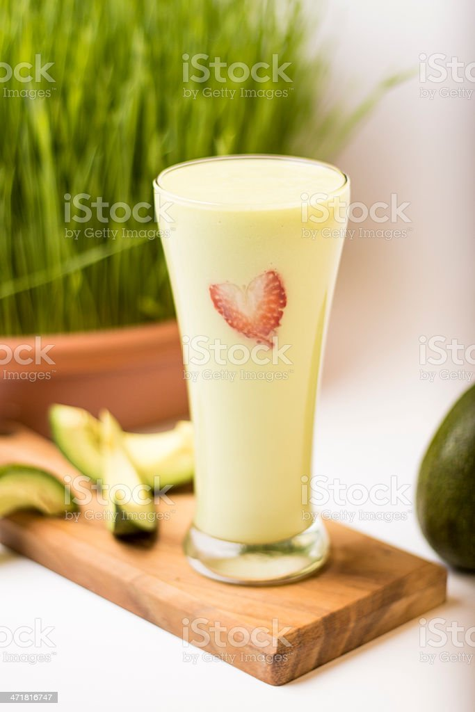 Avocado Smoothie with Wheat Grass royalty-free stock photo