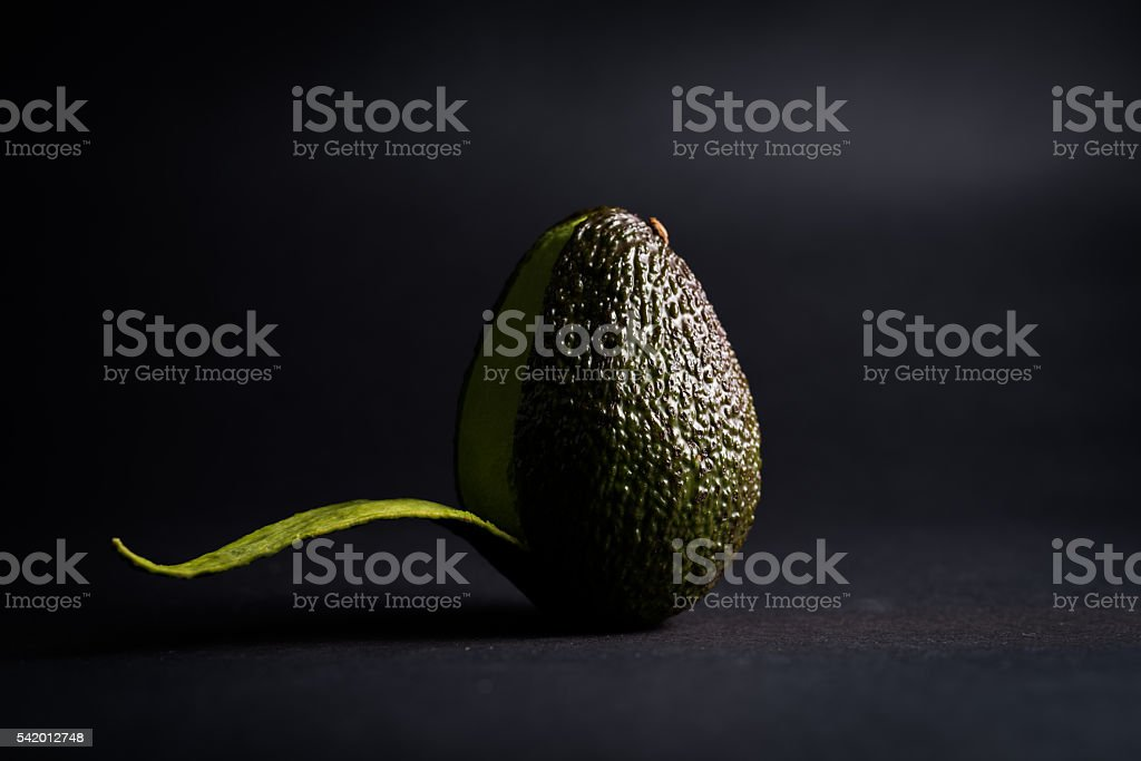 Avocado Striptease on black stock photo
