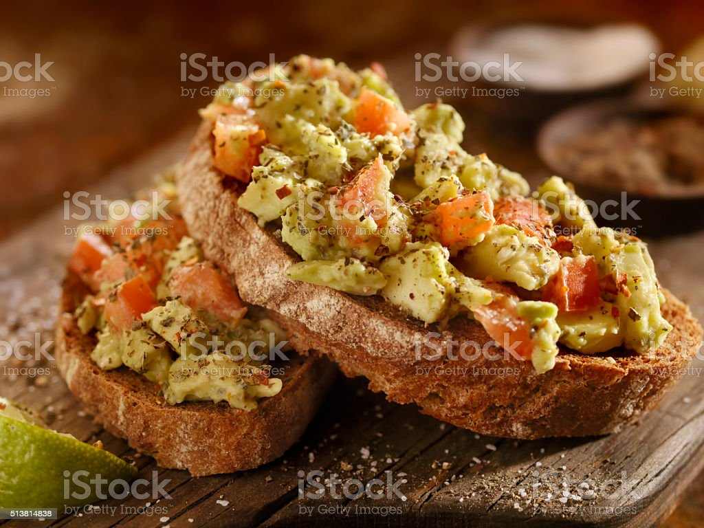 Avocado Toast with Tomatoes on Rye Bread stock photo