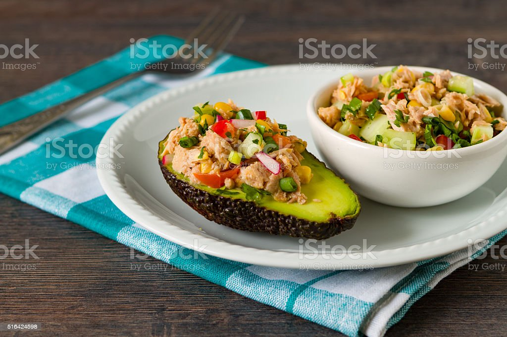Avocado, tuna and vegetables salad stock photo