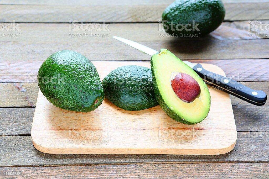 Avocado whole and sliced royalty-free stock photo