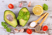 Avocado with ingredients and spices to avocado paste or guacamole