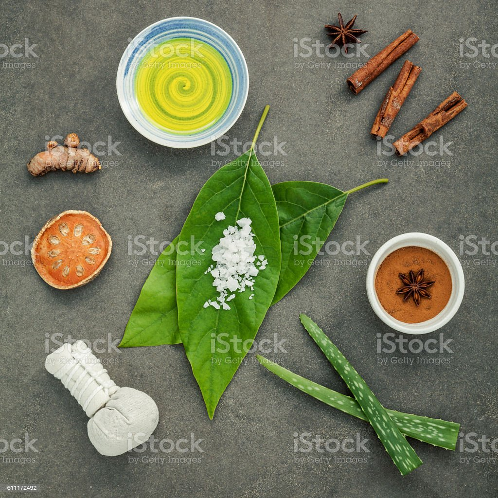 Avocados leaves with nature spa ingredients turmeric,herbal comp stock photo