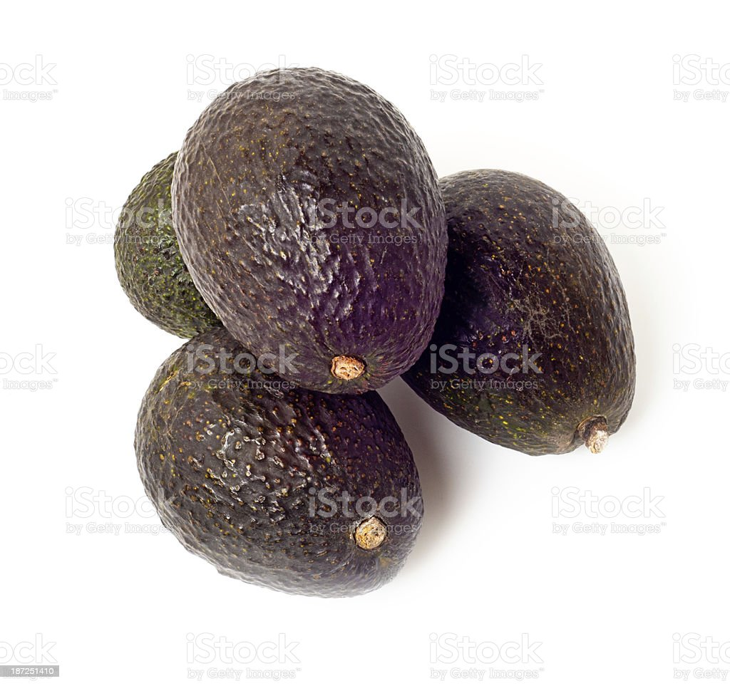 Avocados, ripe and dark brown, Isolated on white royalty-free stock photo