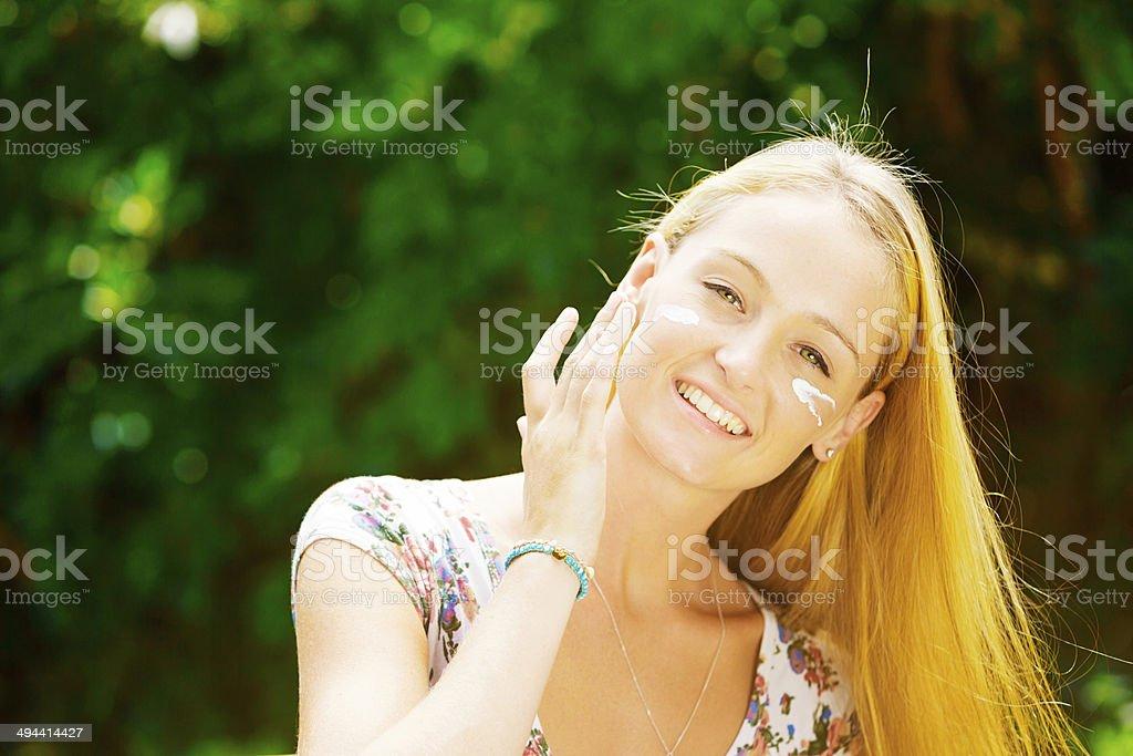 Avoid wrinkles - use sun protection! stock photo