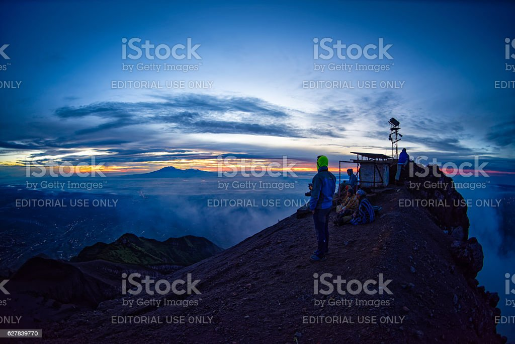 Awaiting for sunrise at Mount Merapi's summit. stock photo
