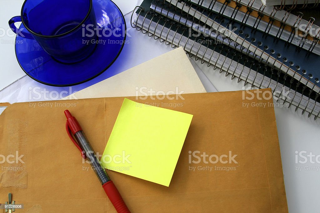Awaiting More Coffee: Blank Post-it, office supplies, empty cup stock photo