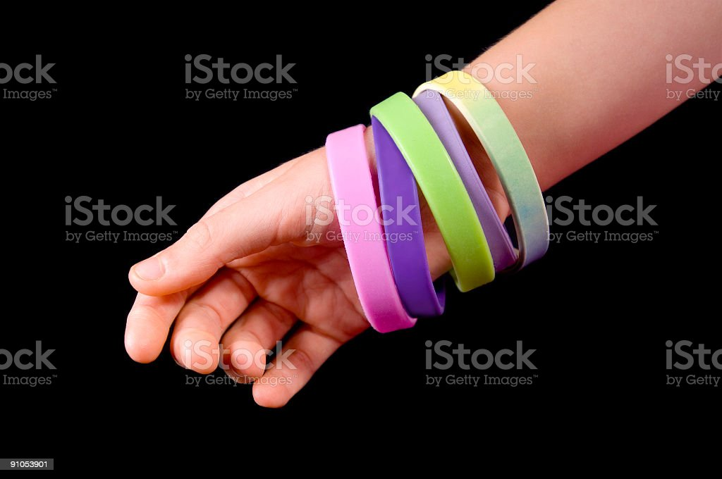 Awareness Bracelets on a wrist royalty-free stock photo